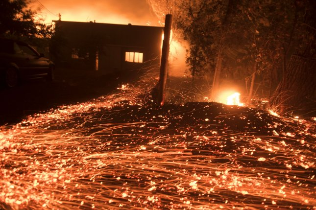 Thousands of spot fires burn from wind-driven embers in Healdsburg, Calif., on Sunday as a result of the Kincade Fire, which has burned 55,000 acres. Photo by Terry Schmitt/UPI