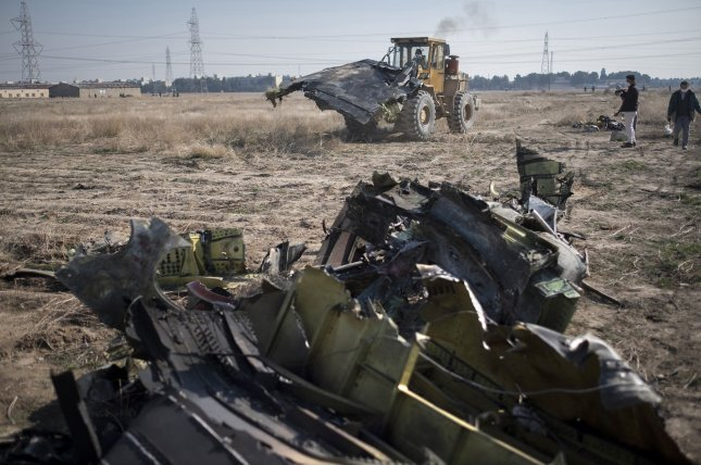 Wreckage of a downed Ukrainian Boeing 737 is seen about 30 miles south of the airport in Tehran, Iran, on January 8, 2020. The crash, later determined to have been caused by a military missile, killed 176 passengers and crew. File Photo by Morteza Nikoubazi/UPI