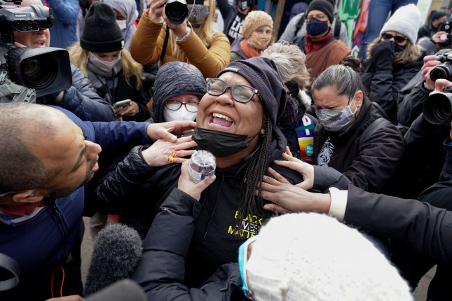 A woman cries at the corner of Chicago Avenue and 38th Street, the site of the murder of George Floyd, as news of Derek Chauvin's guilty verdict is delivered following the second day of jury deliberations in Minneapolis, Minn., on Tuesday. Photo by Jemal Countess/UPI