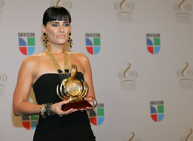 Nelly Furtado celebrates with her 2010 Premio Lo Nuestro award in the media room at American Airlines Arena in Miami, Florida on February 18, 2010. UPI/Martin Fried