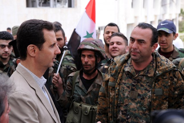 In this photo released by Syria's national news agency, Syrian President Bashar al-Assad talks to soldiers during his visit to the Christian town of Maaloua, northeast of Damascus, on April 20, 2014. On January 26, 2016, government forces captured the strategically important town of Sheikh Miskeen, which lies at a vital intersection in southern Syria's Daraa province. Photo by UPI