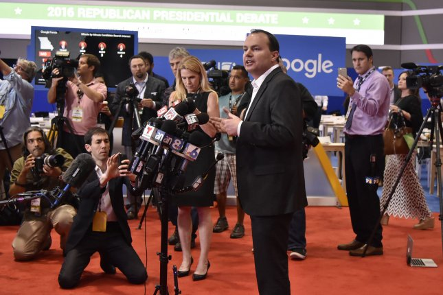 Sen. Mike Lee of Utah endorses Republican candidate Ted Cruz for president during a press conference at the site of Thursday's GOP debate at the University of Miami. Lee's endorsement is a blow to Sen. Marco Rubio, who is friendly with Lee. Photo by Gary I. Rothstein/UPI