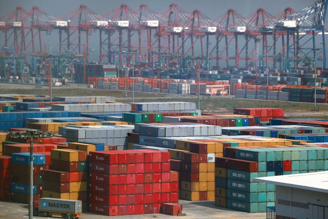 One of China's top ports, in Nansha, a major city on the Pearl River in Southern China's Guangdong Province. China has rapidly grown into a global manufacturing power with its entry into the World Trade Organization, but the country as a whole remains relatively backward in service industries like financing, shipping, commerce, trade and culture compared with developed countries. File Photo by Stephen Shaver/UPI