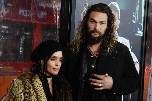 Jason Momoa (R) and wife Lisa Bonet at the Los Angeles premiere of Live by Night on Monday. The actor plays Aquaman in the DC Comics cinematic universe. File Photo by Jim Ruymen/UPI