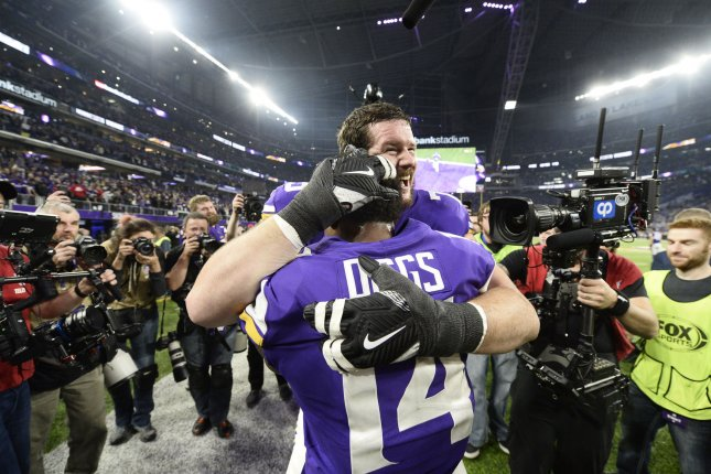 Minnesota Vikings offensive guard Jeremiah Sirles (R) hugs teammate Stefon Diggs after Diggs caught the game-winning touchdown pass during the fourth quarter of the NFC Divisional round playoff game against the New Orleans Saints at U.S. Bank Stadium in Minneapolis on January 14, 2018. The Vikings defeated the Saints 29-24 to advance to the NFC Championship Game. Photo by Brian Kersey/UPI
