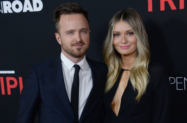 The Path star Aaron Paul (R) and director Lauren Parsekian. The Path has been canceled after three seasons. File Photo by Jim Ruymen/UPI