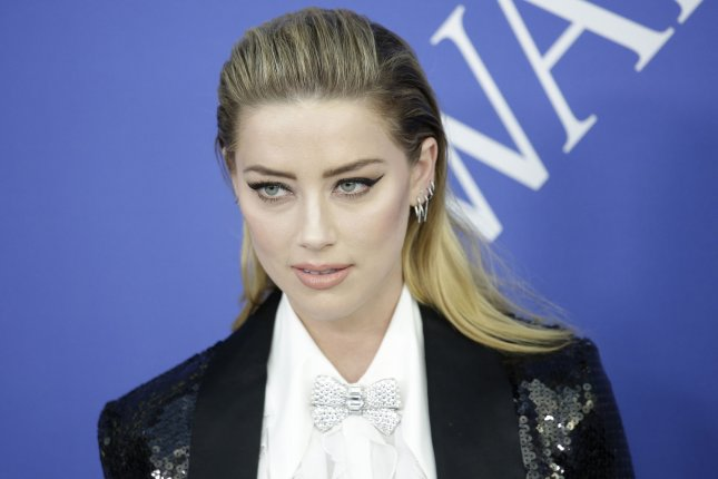 Amber Heard was spotted holding hands with Vito Schnabel at Wimbledon. File Photo by John Angelillo/UPI