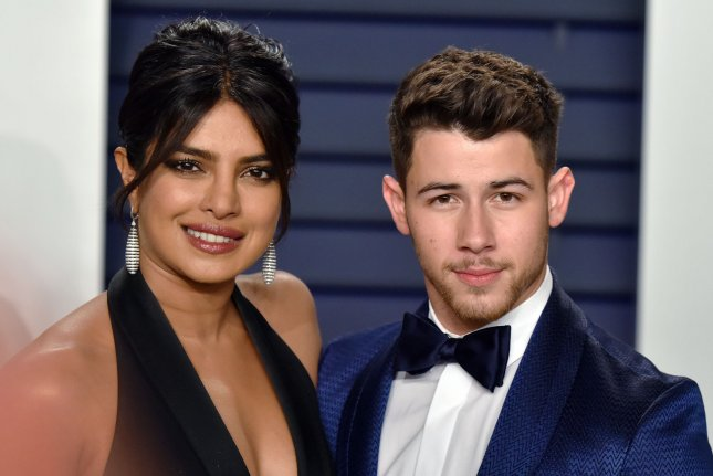 Nick Jonas (R), pictured with Priyanka Chopra, will take the stage with the Jonas Brothers at iHeartRadio Wango Tango in June. File Photo by Christine Chew/UPI