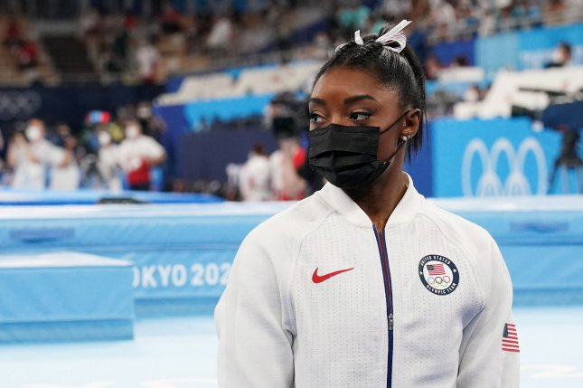 Simone Biles watches her team compete after pulling out of competitions at the women's artistic team all-around finals at the Tokyo 2020 Summer Olympic Games on Tuesday. Photo by Richard Ellis/UPI