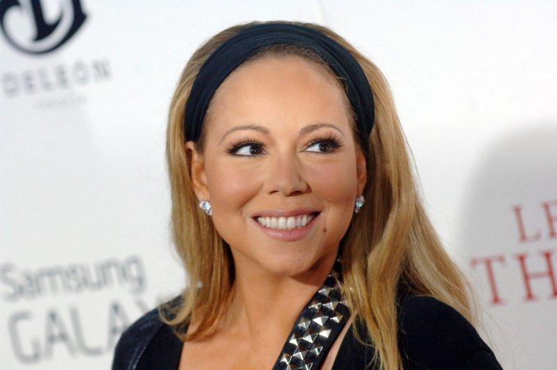 Mariah Carey wasn't specifically calling Nicki Minaj Satan, husband Nick Cannon said. UPI/Dennis Van Tine