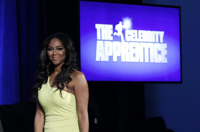Kenya Moore arrives on the stage at the Celebrity Apprentice Season 14 red carpet and press conference at Chelsea Piers in New York City on March 20, 2014. UPI/John Angelillo
