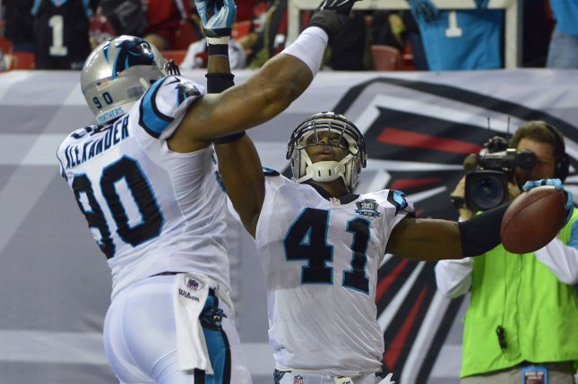 Carolina Panthers safety Roman Harper (41) celebrates with Frank Alexander (90) after Harper's 31-yard touchdown interception from Atlanta Falcons quarterback Matt Ryan during the first half of their NFL game at the Georgia Dome on December 28, 2014, in Atlanta. UPI/David Tulis