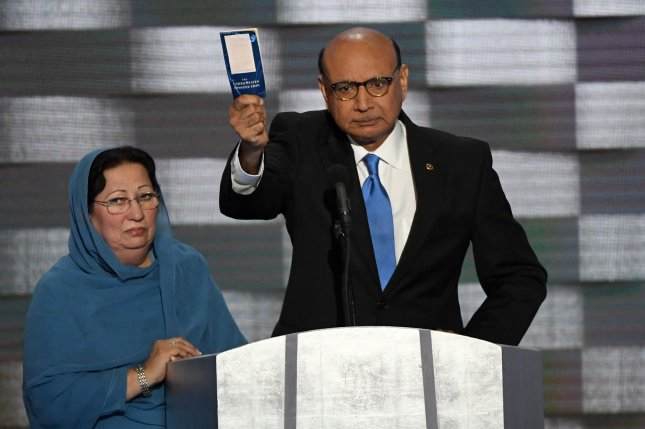 Khizr Khan, whose son, U.S. Army Capt. Humayun Khan, was killed in Iraq, brandishes a copy of the U.S. Constitution as he addresses delegates at the Democratic National Convention. Khan questioned whether, considering his proposal to ban Muslim immigration, Trump had ever read the document. Photo by Pat Benic/UPI