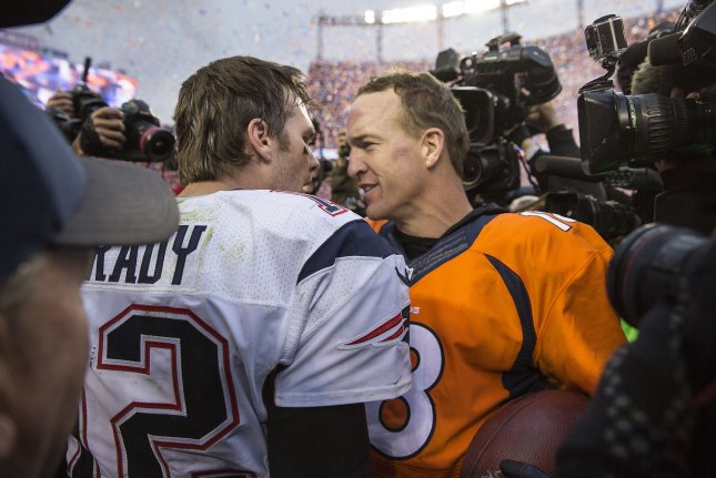 New England Patriots quarterback Tom Brady (L) congratulates Denver Broncos quarterback Peyton Manning after the AFC Championship game at Sport Authority Field at Mile High in Denver on January 24, 2016. Denver advances to Super Bowl 50 defeating New England 20-18. Photo by Gary C. Caskey/UPI
