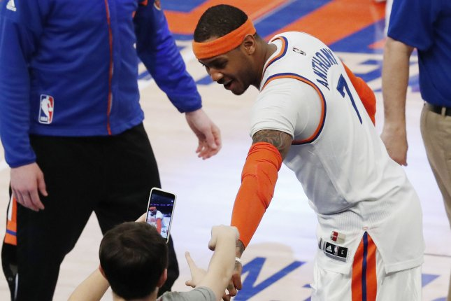 New York Knicks Carmelo Anthony interacts with fans before the game against the Charlotte Hornets at Madison Square Garden in New York City on January 27, 2017. The Knicks are actively trying to trade Anthony who has two years and almost $53 million remaining on his contract. Photo by John Angelillo/UPI