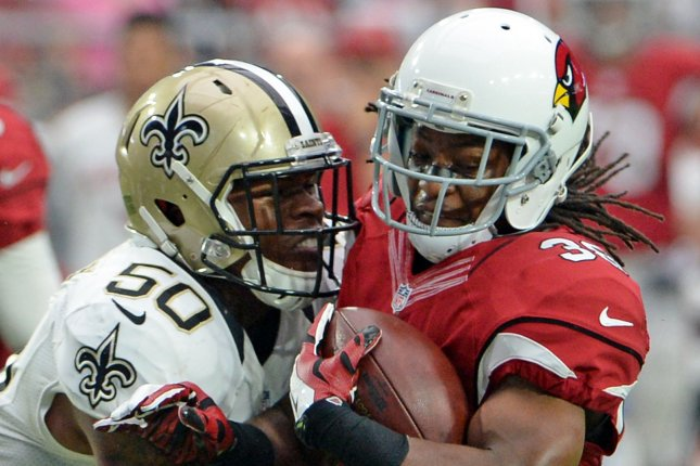 Arizona Cardinals Andre Ellington (right) is stopped for a two yard loss by New Orleans Saints Stephone Anthony in the first quarter of the Cardinals-Saints game at University of Phoenix Stadium in Glendale, Arizona, September 13, 2015. File photo by Art Foxall/UPI
