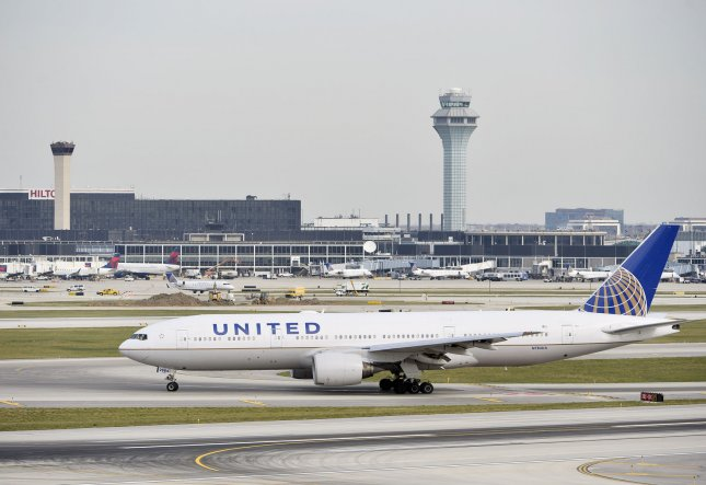 A United Airlines plane taxis at Chicago's O'Hare International Airport, where a passenger was dragged from a flight to Kentucky on April 9 to make room for a flight crew. File Photo by Brian Kersey/UPI