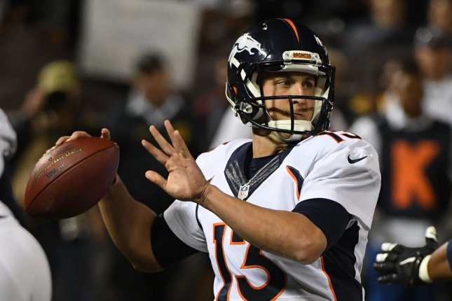 Denver Broncos QB Trevor Siemian (13) throws in the first quarter against the Oakland Raiders at the Oakland-Alameda County Coliseum in Oakland, California on November 6, 2016. File photo by Terry Schmitt/UPI