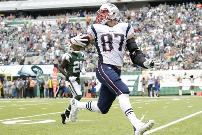New England Patriots tight end Rob Gronkowski celebrates as he runs into the end zone scoring on a 33 yard touchdown reception in the 3rd quarter against the New York Jets in Week 6 of the NFL on October 15 at MetLife Stadium in East Rutherford, N.J. Photo by John Angelillo/UPI