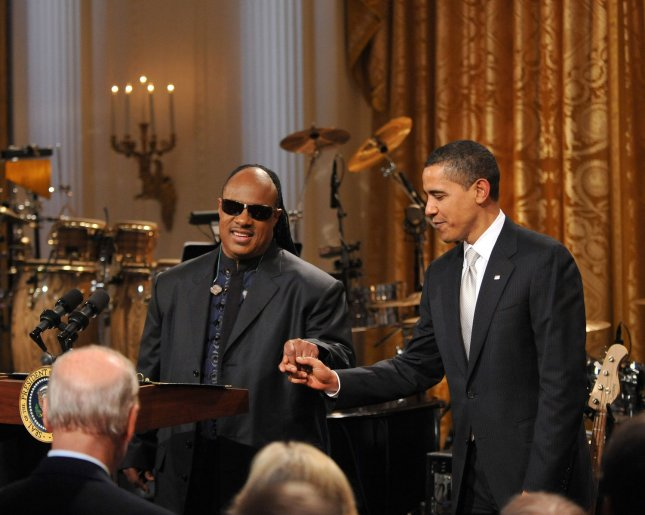 Stevie Wonder makes remarks as United States President Barack Obama looks on during special event hosted by the Obamas in honor of musician Stevie Wonder's receipt of the Library of Congress Gershwin Prize for Popular Song in the East Room of the White House in Washington on Wednesday, February 25, 2009. (UPI Photo/Ron Sachs/Pool)