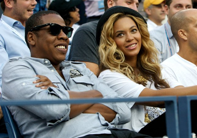 Beyonce Knowles and rapper Jay Z have named their new daughter Blue Ivy Carter, the couple announced in New York. Pictured with Jay Z Sept. 12 in New York. UPI/Monika Graff
