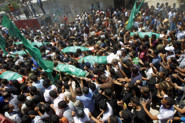 Mourners carry the bodies of Palestinian members of al-Haj family, who medics said were killed in an early morning air strike that destroyed at least two homes, during their funeral in Khan Younis, in the southern Gaza Strip July 10, 2014. At least 85 Palestinians have been killed in Israel's Gaza offensive, Palestinian officials said on Thursday. Palestinian militants continue to fire rockets at Israel, disrupting life but causing little damage and no deaths. UPI/Ismael Mohamad