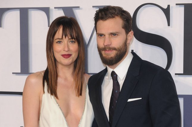 Jamie Dornan, right, and Dakota Johnson at the London premiere of 'Fifty Shades of Grey' on Feb. 12. The actors will shoot the movie's sequels back to back in 2016. File Photo by Paul Treadway/UPI