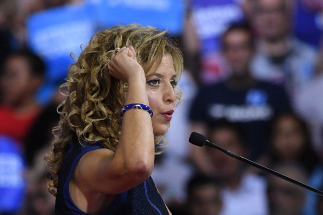DNC Chairwoman Debbie Wasserman Schultz talks to Clinton supporters at a rally at Florida International University Arena, Miami, Florida, Saturday before presumptive Democratic nominee Hillary Clinton introduces her pick for vice president, Sen. Tim Kaine. Wasserman Schultz announced Sunday she will depart as DNC chairwoman after the convention in Philadelphia this week. Photo by Gary I Rothstein/UPI