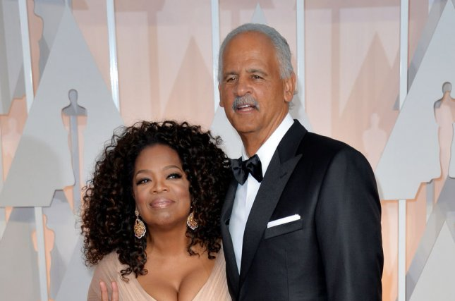 Oprah Winfrey (L) and Stedman Graham at the Academy Awards on February 22, 2015. File Photo by Kevin Dietsch/UPI