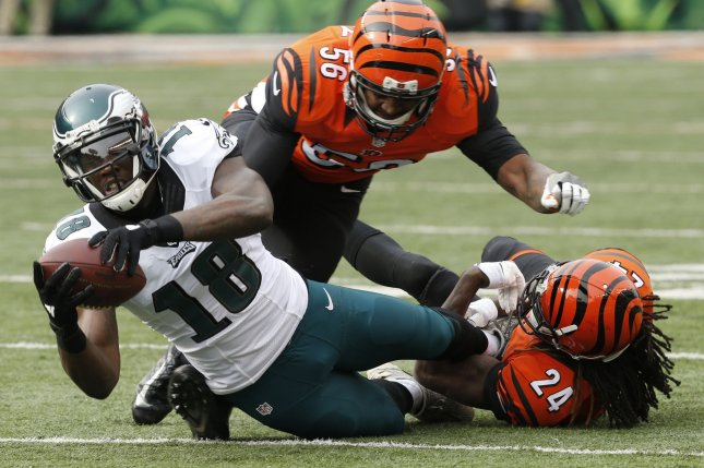 Philadelphia Eagles wide receiver Dorial Green-Beckham (18) is tackled by Cincinnati Bengals CB Adams Jones (24) during the first half of play on December 4 at Paul Brown Stadium in Cincinnati, Ohio. File Photo by John Sommers II/UPI