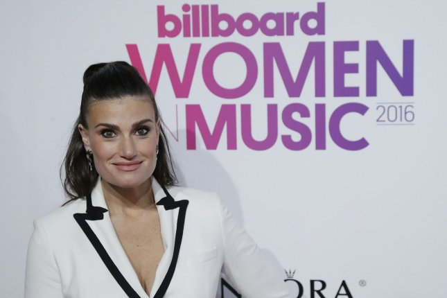 Idina Menzel arrives on the red carpet at the Billboard Women in Music 2016 event on December 9, 2016 in New York City. Menzel married her longtime beau Aaron Lohr during the weekend. Photo by John Angelillo/UPI