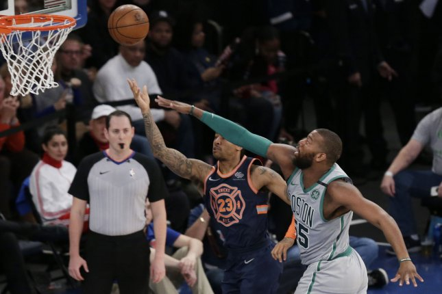 Former Boston Celtics and Toronto Raptors center Greg Monroe (R) is set to head to the Philadelphia 76ers to help them in their upcoming NBA playoff run. File Photo by John Angelillo/UPI