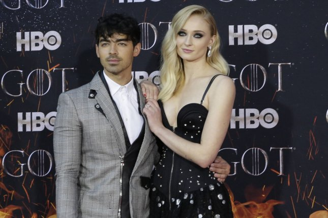 Joe Jonas (L) and Sophie Turner arrive on the red carpet at the Season 8 premiere of Game of Thrones. Jonas prepared for the show returning by dressing up as Turner from the HBO drama. File Photo by John Angelillo/UPI