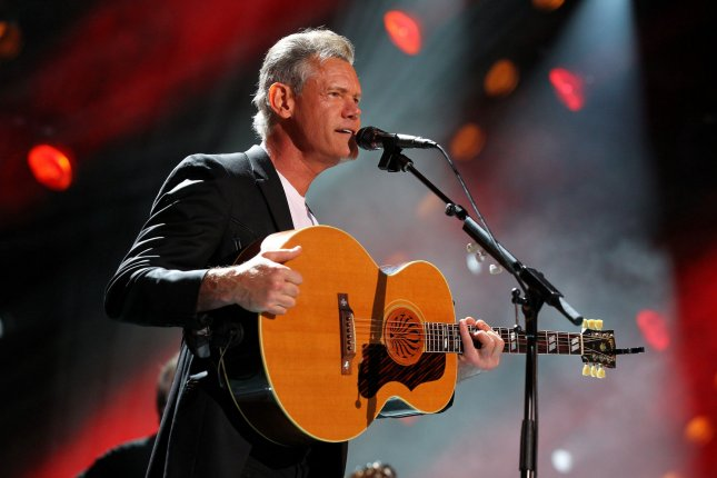Randy Travis and his wife, Mary Davis, gave an update on his health following his near-fatal stroke. File Photo by Terry Wyatt/UPI