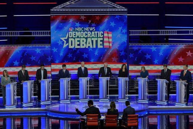 Democratic presidential candidates are seen on stage Thursday at the Knight Concert Hall in Miami, Fla. Photo by Gustavo Cabellero /NBC News/MSNBC/Telemundo/UPI