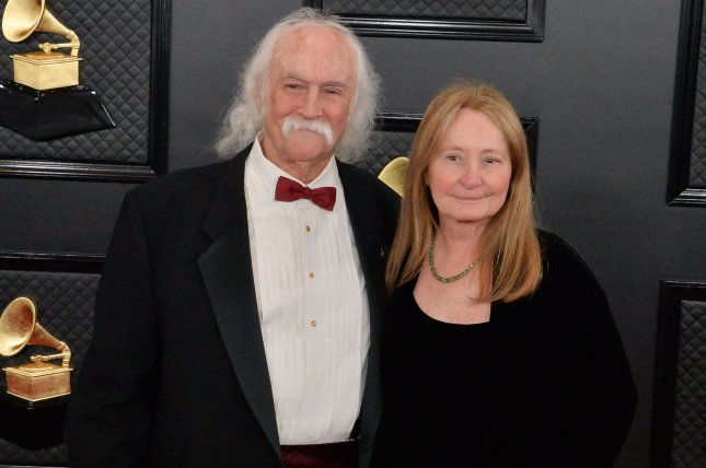 David Crosby (R) and his wife Jan Dance arrive for the 62nd annual Grammy Awards on January 26. Crosby will be headlining a Kent State University benefit concert with Joe Walsh. File Photo by Jim Ruymen/UPI