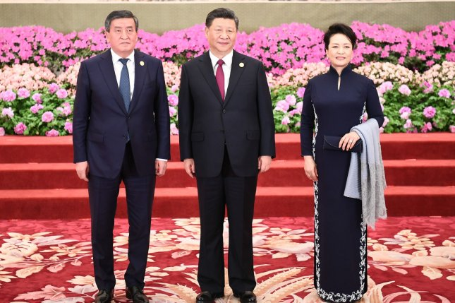Kyrgyz President Sooronbay Jeenbekov is pictured in Beijing, China, on April 24, 2019, standing with Chinese President Xi Jinping and Xi's wife Peng Liyuan. File Photo by Xie Huanchi/UPI