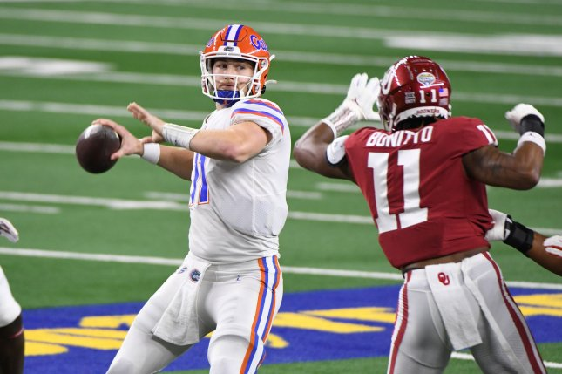 Former Florida Gators quarterback Kyle Trask (L), shown Dec. 30, 2020, was the sixth quarterback taken in this year's draft. File Photo by Ian Halperin/UPI