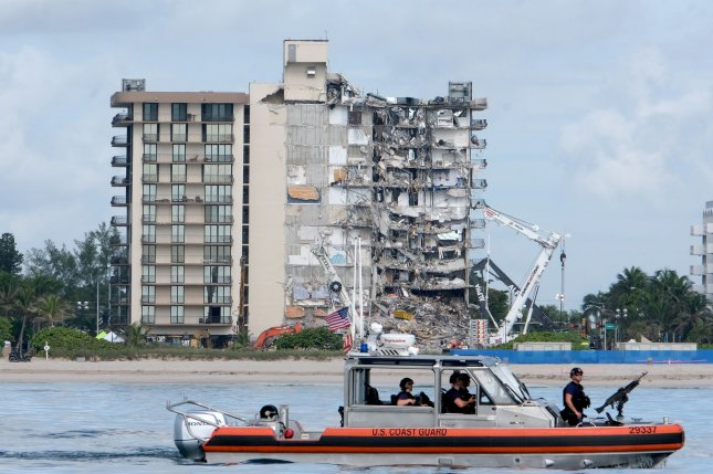 A police boat patrols the water near a partially collapsed condominium building Thursday in Surfside, Fla. Photo By Gary I Rothstein/UPI