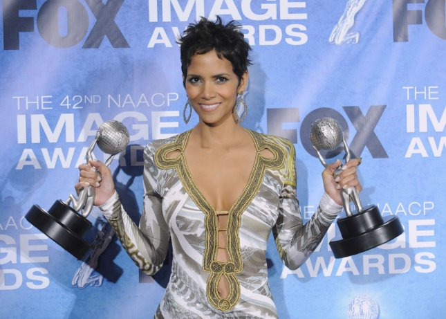 Halle Berry poses backstage with her award at the 42nd NAACP Image Awards Awards held at the Shrine Auditorium in Los Angeles on March 4, 2011. UPI/Phil McCarten