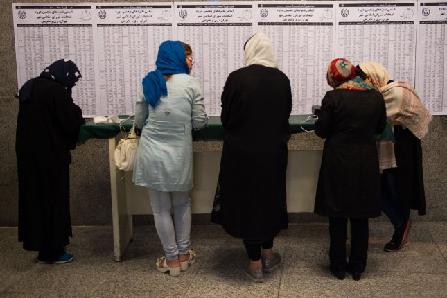 People cast their votes in the Iranian presidential election in Tehran, Iran on May 19. Despite a strong turnout of women in the vote, President Hassan Rouhani doesn't plan to appoint any to his Cabinet. File Photo by Ali Mohammadi/UPI