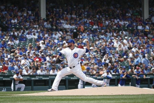 Chicago Cubs starting pitcher Jon Lester delivers against the San Diego Padres in the first inning on August 5 at Wrigley Field in Chicago. Photo by Kamil Krzaczynski/UPI