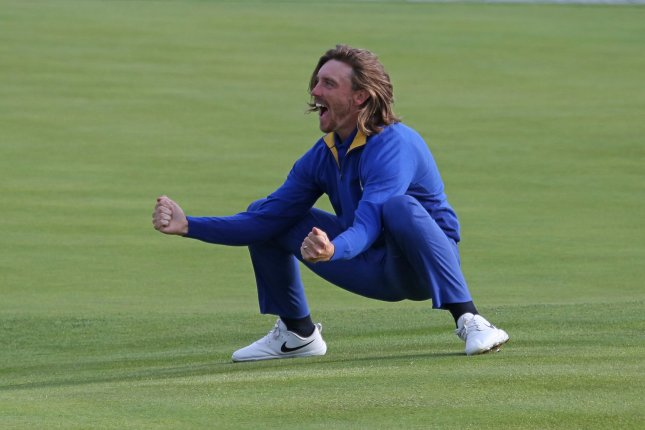 Tommy Fleetwood celebrates after Team Europe clinches the Ryder Cup at Le Golf National in Guyancourt near Paris on September 30, 2018. Team Europe defeated Team USA 17.5 to 10.5 to hand the Americans their sixth straight loss on foreign soil. Photo by David Silpa/UPI