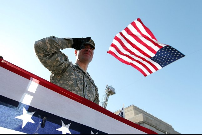 A U.S. Army veteran salutes the American flag while riding in a parade in St. Louis on January 28, 2012. Photo by Bill Greenblatt/UPI