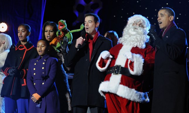 U.S. President Barack Obama, the First Family, Santa Claus and others sing during the 2011 National Christmas Tree Lighting on the Ellipse in Washington, DC, on December 1, 2011. From left are Malia, Sasha, First Lady Michelle Obama, Kermit the Frong, Carson Daly, Santa Claus and President Obama. UPI/Roger L. Wollenberg