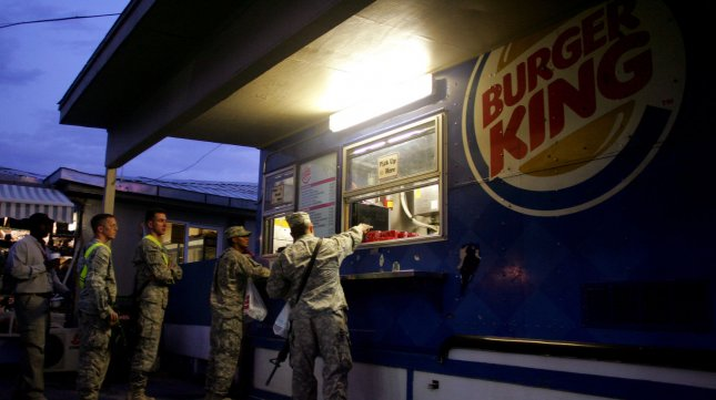 U.S. service members stand in line to get their hamburger at Burger King at the main U.S. base in Bagram. File.