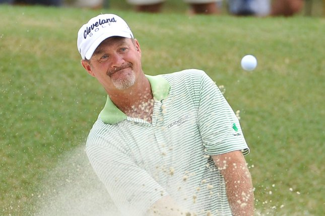 Jerry Kelly chips out of a bunker. UPI/Brian Kersey