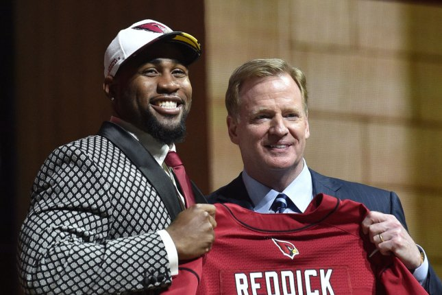 Haason Reddick poses for photographs with NFL Commissioner Roger Goodell after being selected by the Arizona Cardinals as the 13th overall pick in the 2017 NFL Draft at the NFL Draft Theater in Philadelphia, PA on April 27, 2017. photo by Derik Hamilton/UPI
