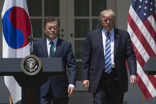 President of South Korea Moon Jae-in and President Donald Trump walk out to take part in a joint statement on the Rose Garden at the White House in Washington, D.C., on Friday. Moon later spoke at the Center for Strategic and International Studies. Photo by Molly Riley/UPI