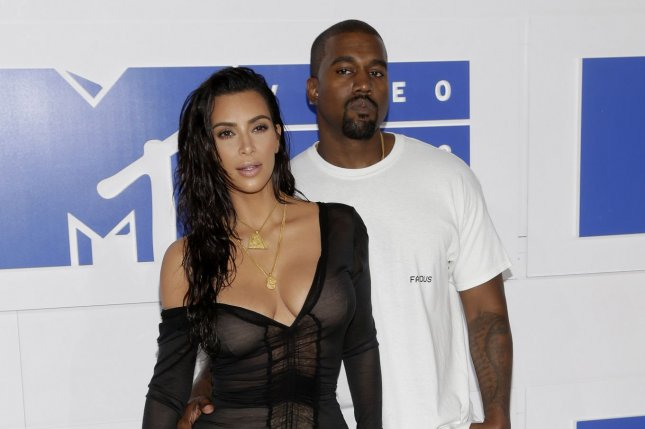 58894aafb4c2 Kanye West and Kim Kardashian's cars burglarized outside their home ...